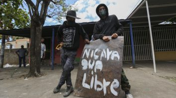 Young demonstrators wait outside the Polytechnic University of Nicaragua, UPOLI, for the day's clashes, in Managua, Nicaragua, Sunday, April 22, 2018. Demonstrators and students have barricaded themselves inside the university campus for several days with police and pro-government supporters laying siege, as protests and disturbances sparked by government social security reforms continued into Sunday. Human rights groups say at least 26 people have been killed in several days of clashes. (AP Photo/Alfredo Zuniga)