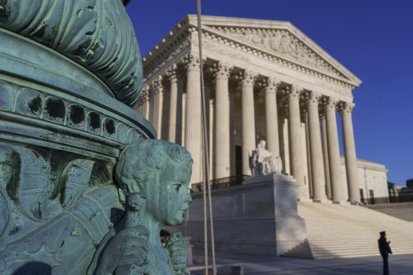 The Supreme Court is seen in Washington, Friday, April 20, 2018. The Supreme Court this week will consider the latest version of President Donald Trump's travel ban against people coming from majority Muslim nations. It will be the high court's first deep dive into a Trump administration policy. (AP Photo/J. Scott Applewhite)