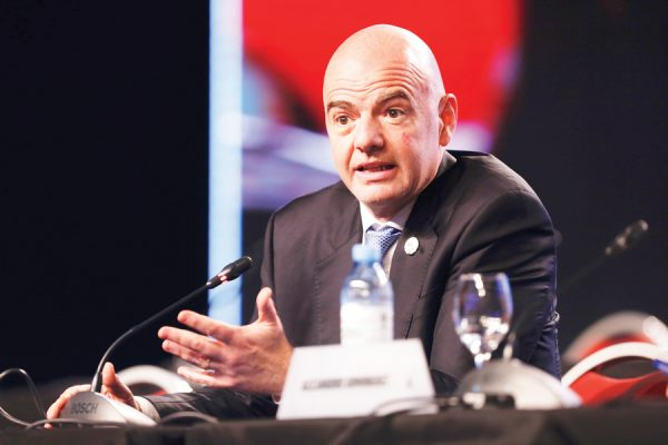 FIFA President Gianni Infantino speaks during the annual conference of the South American Football Confederation, CONMEBOL, in Buenos Aires, Argentina, Thursday, April 12, 2018. The governing body of South American soccer has asked FIFA to expand the World Cup to 48 teams for the 2022 tournament in Qatar. (AP Photo/Martin Ruggiero)