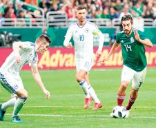 Mexico forward Rodolfo Pizarro (14) attempts to evade Bosnia and Herzegovina's Daniel Garaovac and Haris Medunjanin (10) during the second half of an international friendly soccer match, Wednesday, Jan. 31, 2018, in San Antonio. Mexico won 1-0. (AP Photo/Darren Abate)