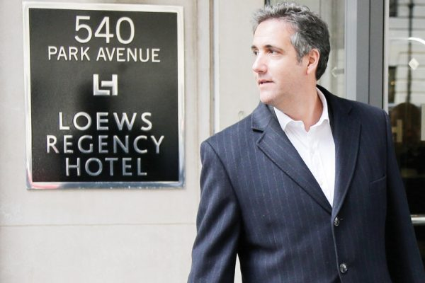 Michael Cohen returns to the hotel where he has been staying in New York, Wednesday, April 11, 2018. (AP Photo/Seth Wenig)
