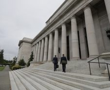 Rob McKenna, left, and Adam Tabor attorneys representing the Washington State Charter Schools Association, walk up the steps of the Temple of Justice, Thursday, May 17, 2018, in Olympia, Wash., before a session of the Washington Supreme Court to hear arguments regarding a lawsuit filed by teachers unions and other groups against Washington state's 2016 charter school law. (AP Photo/Ted S. Warren)