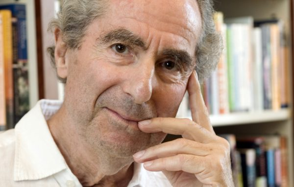 FILE - In this Sept. 8, 2008, file photo, author Philip Roth poses for a photo in the offices of his publisher, Houghton Mifflin, in New York. Roth, prize-winning novelist and fearless narrator of sex, religion and mortality, has died at age 85, his literary agent said Tuesday, May 22, 2018. (AP Photo/Richard Drew, File)