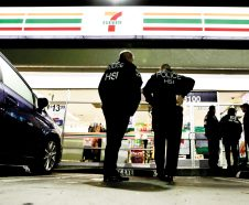 FILE - In this Jan. 10, 2018, file photo U.S. Immigration and Customs Enforcement agents serve an employment audit notice at a 7-Eleven convenience store in Los Angeles. Immigration officials have sharply increased audits of companies to verify that their employees are authorized to work in the country, signaling the Trump administration's crackdown on illegal immigration is reaching deeper into the workplace to create a