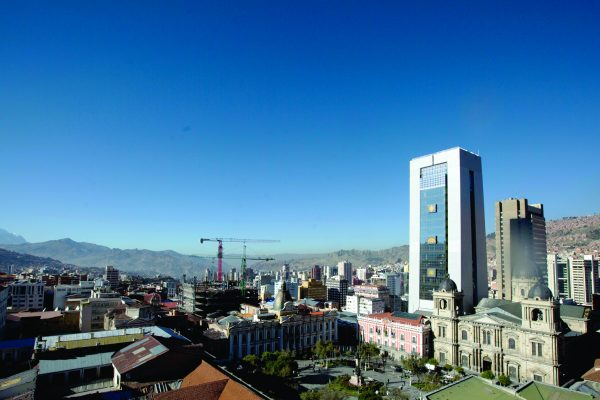 Bolivia's new presidential palace stands out in the historical district of downtown La Paz, Bolivia, June 20, 2018. President Evo Morales will open the new 28-floor presidential palace, that includes a helipad, a suite with a Jacuzzi, massage room and gym, that has cost just over 34 million dollars of South America's poorest nation. (AP Photo/Juan Karita)