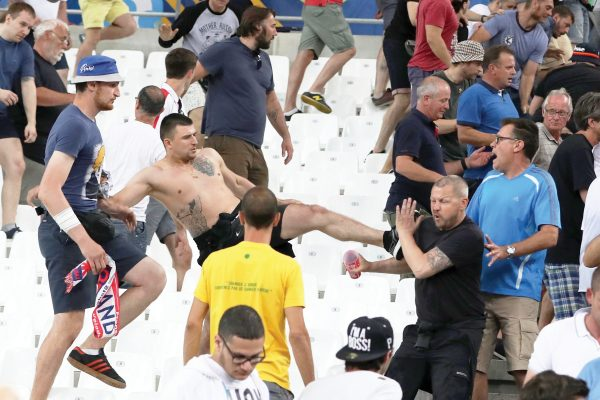 FILE - In this file photo taken on Thursday, June 9, 2016, clashes break out in the stands after the Euro 2016 Group B soccer match between England and Russia, at the Velodrome stadium in Marseille, France. The violence in Marseille was greeted with jokes and even praise from some Russian lawmakers and officials. But ahead of the World Cup, Russian authorities are cracking down on the hooligan culture. (AP Photo/Thanassis Stavrakis, File)