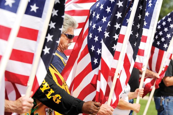 Mark Baidas holds a flag during the Memorial Day ceremony on Monday, May 29, 2017, at the Texas State Veterans Cemetery at Abilene, in Abilene, Texas. (Tommy Metthe/The Abilene Reporter-News via AP)
