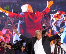 In this Wednesday, June 27, 2018 photo, presidential candidate Andres Manuel Lopez Obrador waves to supporters at his closing campaign rally in Mexico City. Despite his new image, the 64-year-old candidate universally called AMLO appears to trust more in his own sense of mission than in the rules of modern economics and vows to wrest control of the country back from the