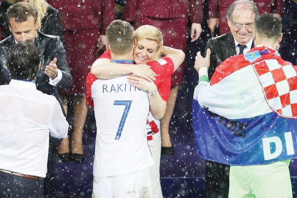 Croatian President Kalinda Grabar-Kitarovic hugs Croatia's Ivan Rakitic at the end of the final match between France and Croatia at the 2018 soccer World Cup in the Luzhniki Stadium in Moscow, Russia, Sunday, July 15, 2018. (AP Photo/Thanassis Stavrakis)