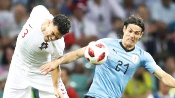 Portugal's Pepe, left, challenges for the ball Uruguay's Edinson Cavani, right, during the round of 16 match between Uruguay and Portugal at the 2018 soccer World Cup at the Fisht Stadium in Sochi, Russia, Saturday, June 30, 2018. (AP Photo/Themba Hadebe)