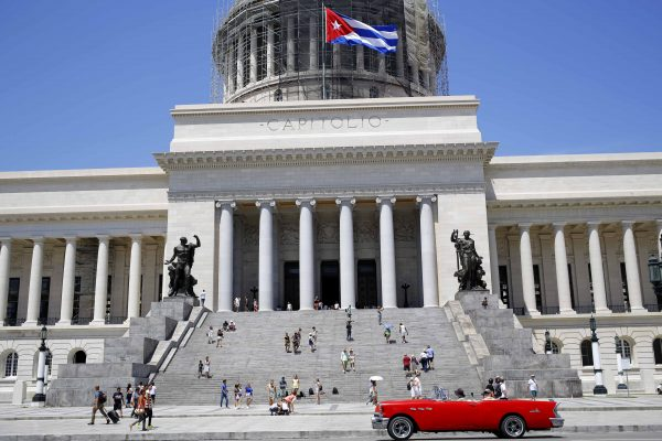 Tourists gather on the steps of the Capitol in Havana, Cuba, Tuesday, Aug. 14, 2018. The Capitol was built in 1929, and after eight years of renovation, it was reopened to visitors this year. (AP Photo/Desmond Boylan)