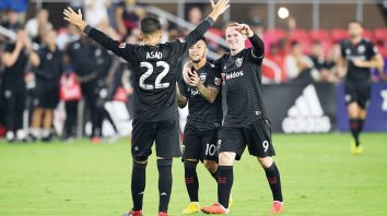 D.C. United midfielder Luciano Acosta (10) celebrates his goal with forward Wayne Rooney (9) and Yamil Asad (22) during the second half of an MLS soccer match against Orlando City, Sunday, Aug. 12, 2018, in Washington. D.C. United won 3-2. (AP Photo/Nick Wass)