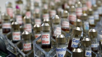 """FILE - This Dec. 4, 2013 file photo shows vials of flavored liquid at a store selling electronic cigarettes and related items in Los Angeles. On Wednesday, Sept. 12, 2018, U.S. health officials said teenage use of e-cigarette has reached """"epidemic"""" levels in the U.S. and are calling on the industry to address the problem or risk having their flavored products pulled off the market. (AP Photo/Reed Saxon, File)"""