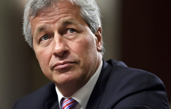 """FILE- In this June 13, 2012, file photo, JPMorgan Chase CEO Jamie Dimon testifies before the Senate Banking Committee on Capitol Hill in Washington. Dimon, is saying he would be able to beat President Donald Trump in an election, but also says he isn't running for the nation's top office. The nation's most powerful banker told reporters at an event at JPMorgan headquarters Wednesday, Sept. 12, 2018, that """"I think I could beat Trump.""""  (AP Photo/J. Scott Applewhite, File)"""
