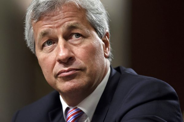 "FILE- In this June 13, 2012, file photo, JPMorgan Chase CEO Jamie Dimon testifies before the Senate Banking Committee on Capitol Hill in Washington. Dimon, is saying he would be able to beat President Donald Trump in an election, but also says he isn't running for the nation's top office. The nation's most powerful banker told reporters at an event at JPMorgan headquarters Wednesday, Sept. 12, 2018, that ""I think I could beat Trump.""  (AP Photo/J. Scott Applewhite, File)"