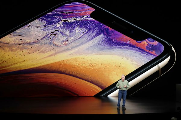 Phil Schiller, Apple's senior vice president of worldwide marketing, speaks about the Apple iPhone XS at the Steve Jobs Theater during an event to announce new Apple products Wednesday, Sept. 12, 2018, in Cupertino, Calif. (AP Photo/Marcio Jose Sanchez)