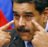 Venezuela's President Nicolas Maduro speaks during a press conference at the Miraflores Presidential Palace, in Caracas, Venezuela, Tuesday, Sept. 18, 2018. Venezuela and China have agreed to joint investments Maduro announced on Tuesday. (AP Photo/Ariana Cubillos)