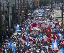 Protestors march against Guatemalan President Jimmy Morales and in support of the fight against corruption, in Guatemala City, Thursday, Sept. 20, 2018. Thousands marched to protest Morales' decision to end the work of a U.N. anti-corruption commission that has helped lead high-profile graft probes targeting dozens of powerful people, including one involving Morales. (AP Photo/Moises Castillo)