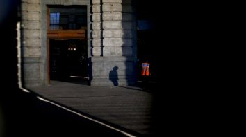 A police walks through the Retiro station, left empty due to a nationwide strike, in Buenos Aires, Argentina, Tuesday, Sept. 25, 2018. Argentine labor unions stage a general strike Tuesday, to protest recent government measures and demand solutions to the country's economic crisis. (AP Photo/Natacha Pisarenko)