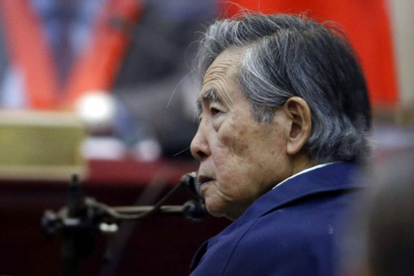 FILE - In this March 15, 2018 file photo, Peru's former President Alberto Fujimori listens to a question during his testimony in a courtroom at a military base in Callao, Peru. The country's high court has overturned on Wednesday, Oct. 3, the former strongman's medical pardon and orders his return to jail. (AP Photo/Martin Mejia, File)