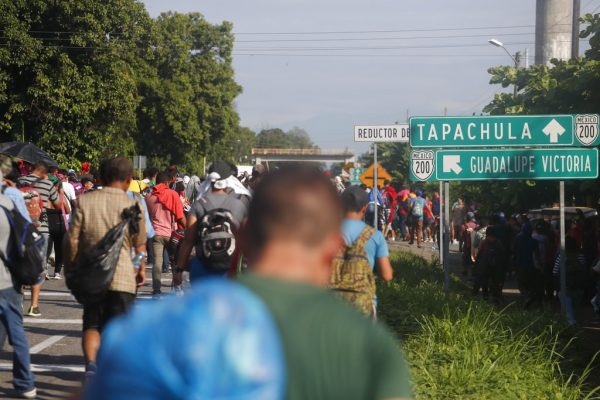 Central American migrants walk north toward Tapachula, after departing Ciudad Hidalgo, Mexico, Sunday, Oct. 21, 2018. Despite Mexican efforts to stop them at the Guatemala-Mexico border, about 5,000 Central American migrants resumed their advance toward the U.S. border early Sunday in southern Mexico. (AP Photo/Moises Castillo)