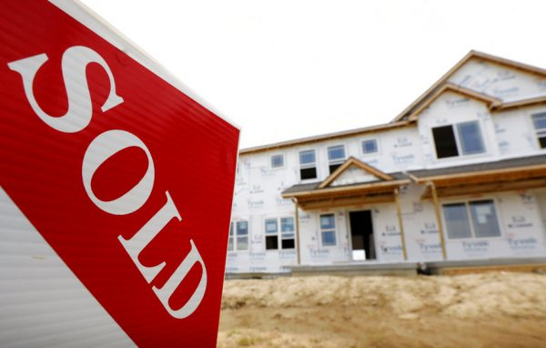 FILE- In this June 27, 2018, file photo, a sold sign stands in front of a home under construction in West Des Moines, Iowa. On Wednesday, Oct. 24, the Commerce Department reports on sales of new homes in September. (AP Photo/Charlie Neibergall, File)