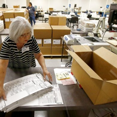 Workers at the Maricopa County Recorder's Office go through ballots Thursday, Nov. 8, 2018, in Phoenix. There are several races too close to call in Arizona, especially the Senate race between Democratic candidate Kyrsten Sinema and Republican candidate Martha McSally. (AP Photo/Ross D. Franklin)