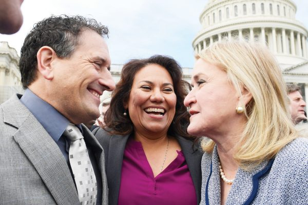 Rep.-elect Andy Levin, D-Mich., left,  Rep.-elect Veronica Escobar, D-Texas, center, and Rep.-elect Sylvia Garcia, D-Texas, right, talk following a photo opportunity on Capitol Hill in Washington, Wednesday, Nov. 14, 2018, for the freshman class. (AP Photo/Susan Walsh)