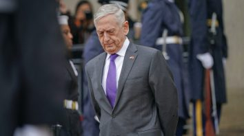 FILE - In this Nov. 9, 2018, file photo, Defense Secretary Jim Mattis waits outside the Pentagon. President Donald Trump says Mattis will be retiring at the end of February 2019 and that a new secretary will be named shortly. (AP Photo/Pablo Martinez Monsivais, File)