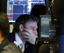 Trader John Romolo works on the floor of the New York Stock Exchange, Thursday, Jan. 3, 2019. Stocks went into a steep slide Thursday after Apple sent a shudder through Wall Street with word that iPhone sales in China are falling. (AP Photo/Richard Drew)