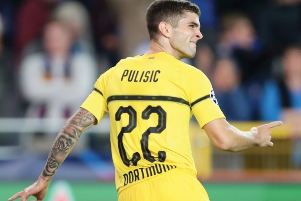 FILE - In this Sept. 18, 2018 file photo Borussia Dortmund's Christian Pulisic celebrates scoring his side's first goal during a Champions League group A soccer match between Club Brugge and Borussia Dortmund at the Jan Breydel Stadium in Bruges, Belgium. Borussia Dortmund said in a statement on Wednesday, Jan. 2, 2019 that Chelsea found an agreement with Pulisic but he will remain on loan in Dortmund until the end of the season.  (AP Photo/Francisco Seco, file)