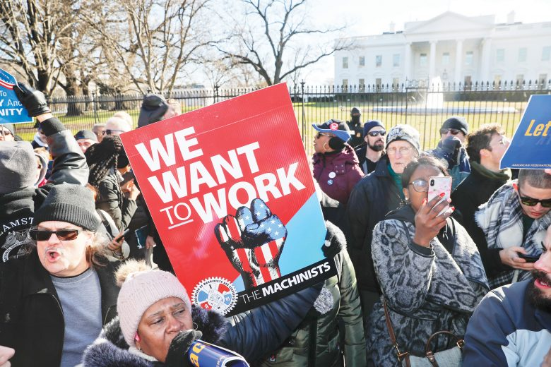 Union members and other federal employees stop in front of the White House in Washington during a rally to call for an end to the partial government shutdown, Thursday, Jan. 10, 2019. . (AP Photo/Pablo Martinez Monsivais)