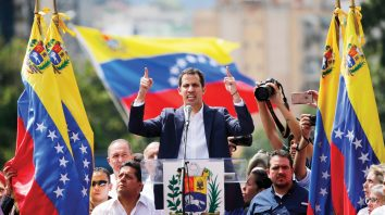 Juan Guaido, head of Venezuela's opposition-run congress, declares himself interim president of the nation until elections can be held during a rally demanding President Nicolas Maduro's resignation in Caracas, Venezuela, Wednesday, Jan. 23, 2019. (AP Photo/Fernando Llano)