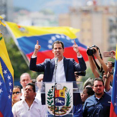 Juan Guaido, head of Venezuela's opposition-run congress, declares himself interim president of the nation until elections can be held during a rally demanding President Nicolas Maduro's resignation in Caracas, Venezuela, Wednesday, Jan. 23, 2019. (AP Photo/Fernando Llano)