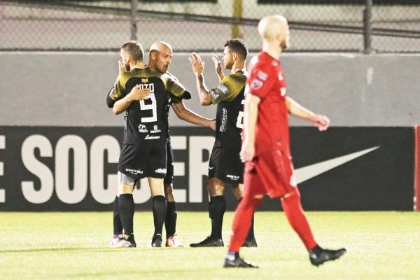Players of Panama's Club Atletico Independiente FC celebrate after defeating Canada's Toronto FC 4-0 during a CONCACAF Champions League soccer match in La Chorrera, Panama, Tuesday, Feb., 19, 2019 (AP Photo/Arnulfo Franco)