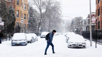 A commuter walks to the train station as snow falls Monday, Jan. 28, 2019, in Chicago. The plunging temperatures expected later this week that have forecasters especially concerned. Wind chills could dip to negative 55 degrees in northern Illinois, which the National Weather Service calls