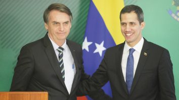 Brazil's President Jair Bolsonaro, left, and Venezuela's self-proclaimed interim president Juan Guaido smile during a joint statement in Brasilia, Brazil, Thursday, Feb.28, 2019. Guaido met Bolsonaro, who recognizes Guaido and has taken a hard line against Venezuelan President Nicolas Maduro. (AP Photo/Lucio Tavora)