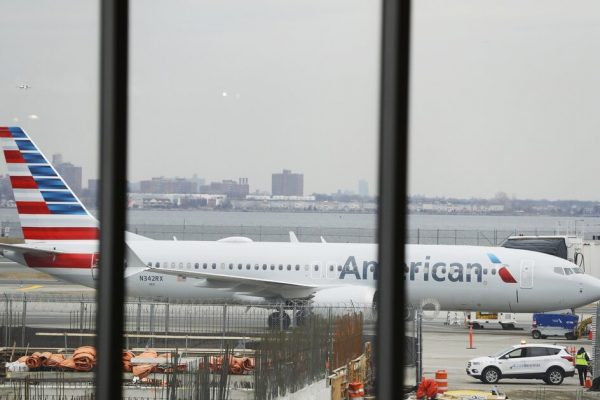An American Airlines Boeing 737 MAX 8  plane sits at a boarding gate at LaGuardia Airport Wednesday, March 13, 2019, in New York. The Federal Aviation Administration issued an emergency order Wednesday grounding all Boeing 737 Max aircraft in the wake of a crash of an Ethiopian airliner that killed 157 people, a reversal for the U.S. after federal aviation regulators had maintained it had no data to show the jets are unsafe. (AP Photo/Frank Franklin II)