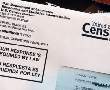 FILE - This March 23, 2018 file photo shows an envelope containing a 2018 census letter mailed to a U.S. resident as part of the nation's only test run of the 2020 Census. As the U.S. Supreme Court weighs whether the Trump administration can ask people if they are citizens on the 2020 Census, the Census Bureau is quietly seeking comprehensive information about the legal status of millions of immigrants. (AP Photo/Michelle R. Smith, File)