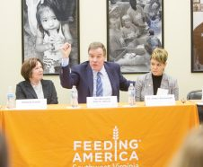 Senator Mark Warner joins a panel at Feeding America Southwest Virginia for a round table discussion about