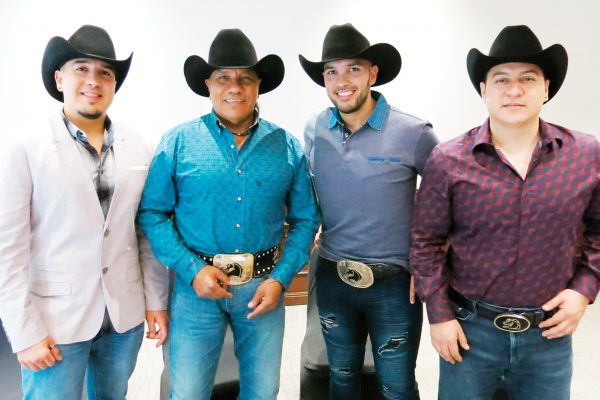 "In this April 2, 2019 photo, members of the Mexican norteño band Bronco, José Adán Esparza, from left, Guadalupe Esparza, René Esparza and Javier Cantú, pose during an interview in Mexico City. Bronco will present the songs of their new record ""Por Más"" at the National Auditorium in Mexico City on June 6, 2019. (AP Photo/Berenice Bautista)"