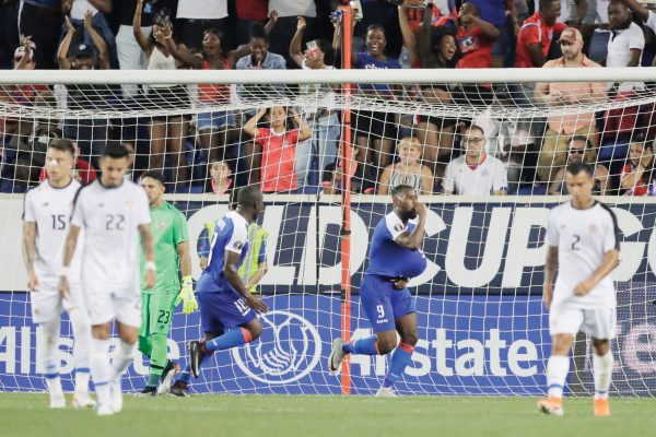 Haiti forward Duckens Nazon, center, celebrates after scoring a penalty kick goal against Leonel Moreira during the second half of a CONCACAF Gold Cup soccer match, Monday, June 24, 2019, in Harrison, N.J. (AP Photo/Julio Cortez)
