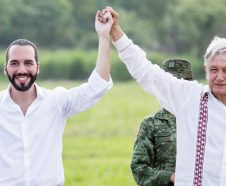 Mexican President Andres Manuel Lopez Obrador, right, and the President of El Salvador Nayib Bukele, raise their arms during a visit to a tree nursery at a military reserve in Tapachula, Mexico, Thursday, June 20, 2019. The presidents met to discuss a development plan that aims to slow a surge of mostly Central American migrants toward the U.S. border. (AP Photo/Oliver de Ros)