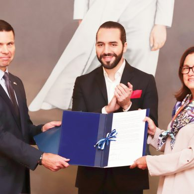 Acting U.S. Homeland Security Secretary Kevin McAleenan, left, holds the letter of understanding with Chancellor Alexandra Hill, while Salvadoran President Nayib Bukele applauds the signing of the agreement, during an official meeting at in San Salvador, El Salvador, Wednesday, Aug. 28, 2019. (AP Photo/Salvador Melendez)