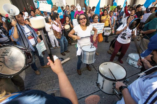 Demonstrators demand the resignation of Guatemalan President Jimmy Morales outside the Presidential House in Guatemala City, Saturday, July 27, 2019. Demonstrators are protesting an agreement their government signed with Washington to require migrants passing through the Central American country to seek asylum there, rather than pushing on to the U.S. (AP Photo/ Oliver de Ros)