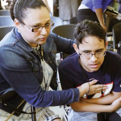 Mariela Sanchez, of Honduras, comforts her son, Jonathan, 16, during a news conference, Monday, Aug. 26, 2019, in Boston. The Sanchez family came to the United States seeking treatment for Jonathan's cystic fibrosis. Doctors and immigrant advocates say federal immigration authorities are unfairly ordering foreign born children granted deferred action for medical treatment to return to their countries. (AP Photo/Elise Amendola)