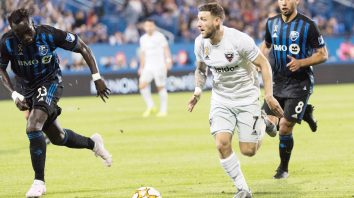 D.C. United's Paul Arriola, right front, breaks away from Montreal Impact's Bacary Sagna and Saphir Taider, right rear, during the second half of an MLS soccer match Saturday, Aug. 31, 2019, in Montreal. (Graham Hughes/The Canadian Press via AP)