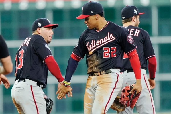 Washington Nationals' Asdrubal Cabrera and Juan Soto celebrate after Game 1 of the baseball World Series against the Houston Astros Tuesday, Oct. 22, 2019, in Houston. The Nationals won 5-4 to take a 1-0 lead in the series. (AP Photo/David J. Phillip)