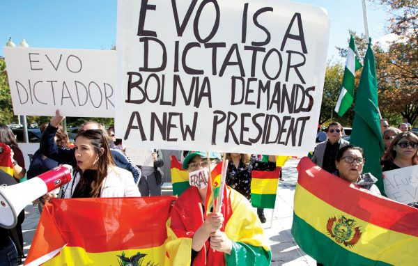 Demonstrators holding up Bolivian flags protest against the Bolivian elections outside of the Organization of American States (OAS) during the Permanent Council special meeting to consider the