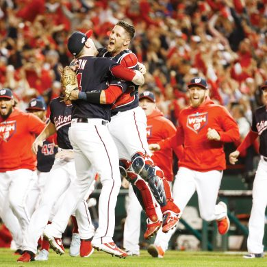 Washington Nationals' Yan Gomes and Daniel Hudson celebrate after Game 4 of the baseball National League Championship Series Tuesday, Oct. 15, 2019, in Washington. The Nationals won 7-4 to win the series 4-0. (AP Photo/Patrick Semansky)